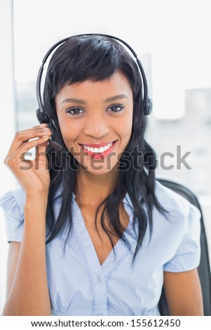 Peaceful operator looking at camera in office - stock photo
