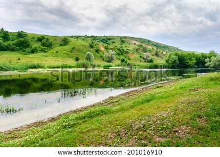 Peaceful riverside of the Seversky Donets River near the village of Zakotnoe around Slovyansk in the Donetsk region, Ukraine - stock photo