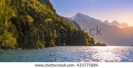 Peaceful scenery with the Swiss Alps and Lake Walensee - lovely spring landscape in Switzerland, with the Swiss Alps and the Walensee lake in the morning sunlight. - stock photo