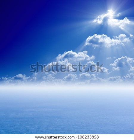 Peaceful sea background, bright sun shines from white clouds - heaven - stock photo
