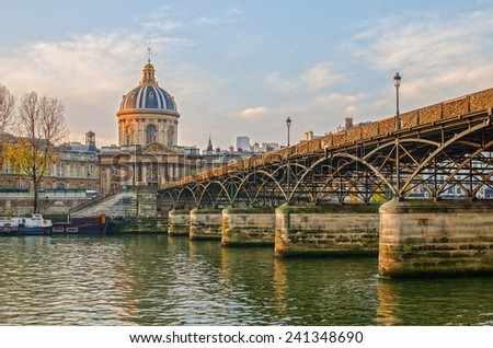 Peaceful Seine river and Old Town of Paris (France) in the calm beautiful sunrise of the autumn. Famous L'Hôtel national des Invalides (The National Residence of the Invalids) in the background.  - stock photo