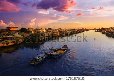 Peaceful sunset on the Mekong river in Viet Nam. This part of the world was quite unpleasant to be in during the Vietnam War, today the calm waters of the Mekong no longer flow red. This is a new era. - stock photo
