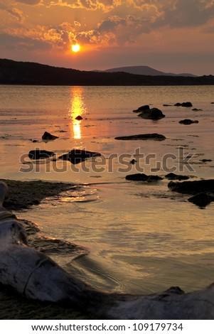 Peaceful sunset over the waters of the sea - stock photo