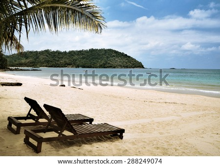 Peaceful view of Tioman costline with two sunbed - stock photo