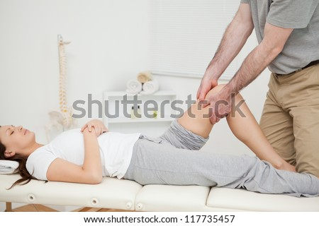 Peaceful woman lying while being manipulated in a medical room