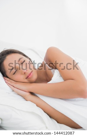 Peaceful woman sleeping in bed in the bedroom