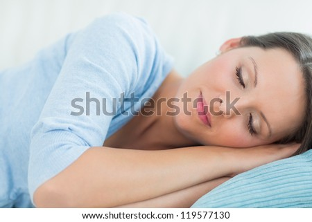 Peaceful woman sleeping on the couch - stock photo