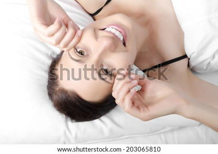 Peaceful woman stretching her body while getting up - stock photo