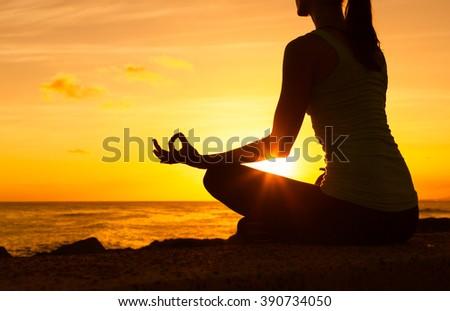 Peaceful yoga on the beach.  - stock photo
