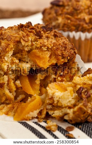 Peach and Granola Breakfast Muffins . Selective focus. - stock photo