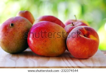 Peach, and mango fruits - stock photo
