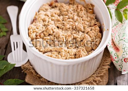 Peach crumble in a white baking dish - stock photo