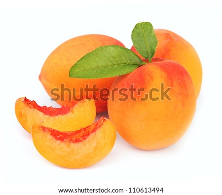 peach fruit and segments of peach isolated on white background