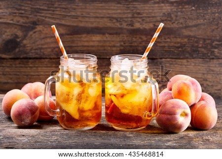 peach iced tea with fresh fruit - stock photo
