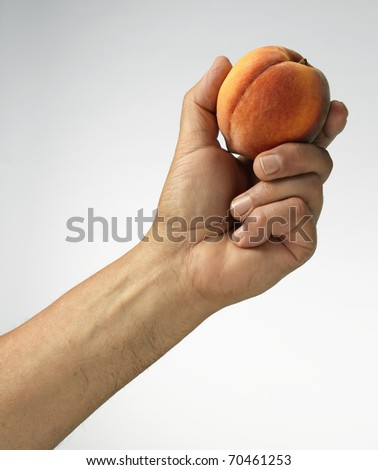 peach in hand - stock photo