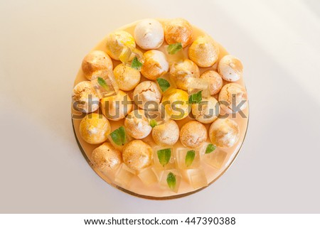 Peach mousse cake with meringue and jelly - stock photo