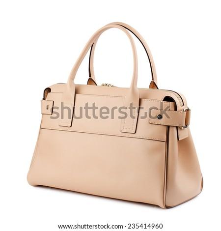 Peach-orange female handbag isolated on white background. - stock photo