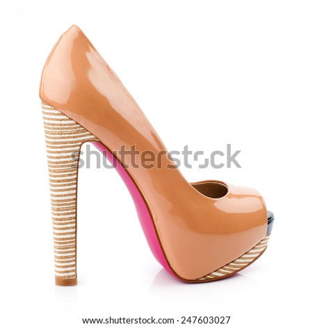 Peach-orange high heel shoe isolated on white background.