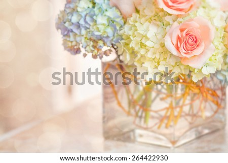 Peach Rose Blue Hydrangea Glass Vase Pastel Bokeh Background - stock photo