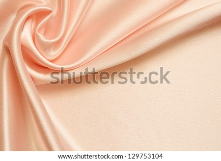 Peach silk background with drapery in the corner - stock photo