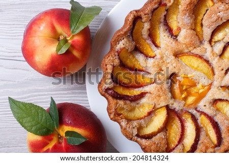 peach tart and fresh fruit closeup on a wooden table top view horizontal  - stock photo