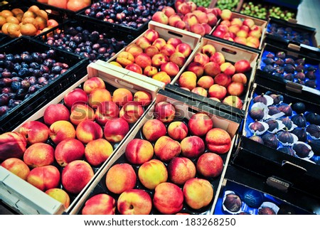 peaches and plums at the grocery store