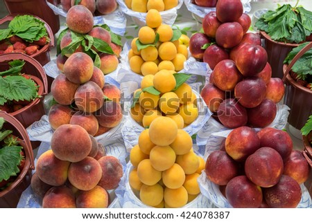 Peaches, apricots and nectarines  for sale at city market. Baku. Azerbaijan