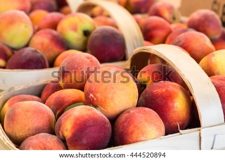 Peaches in baskets for sale at the farmers market in Asheville North Carolina