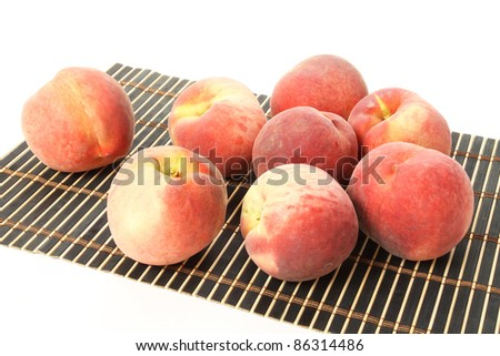 peaches on a white background. - stock photo