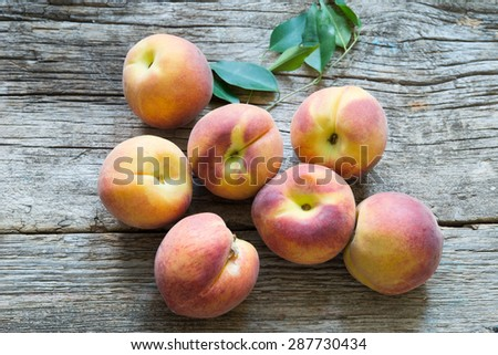 Peaches on a wooden background - stock photo