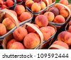 Peaches on sale at farmers market - stock photo