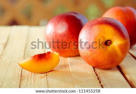 peaches on the wooden background - stock photo