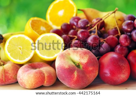 peaches,pears, grapes and sliced citrus fruits - stock photo