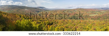 Peak Autumn Colors on Belleayre Mountain and Brush Ridge seen from a ledge on Monka Hill in the Catskills Mountain of upstate New York. - stock photo