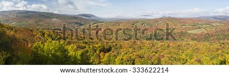 Peak Autumn Colors on Belleayre Mountain and Brush Ridge seen from a ledge on Monka Hill in the Catskills Mountain of upstate New York. - stock photo