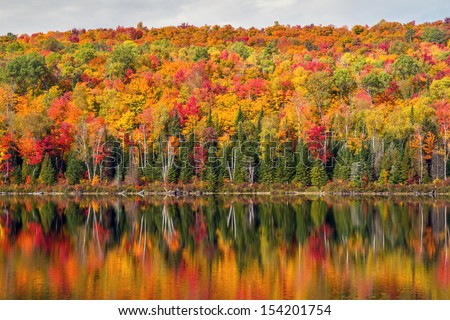 Peak Autumn reflection - stock photo