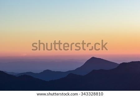 peak of mountain in sunset - stock photo