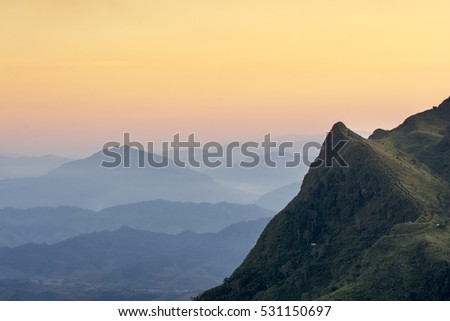 peak of mountains and warm tone sky sunset times