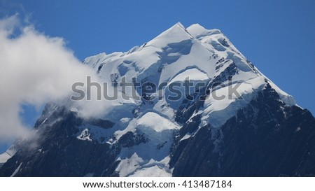 Peak of Mt Cook and cloud. Highest mountain in New Zealand. - stock photo
