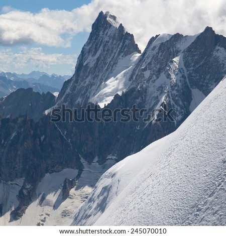 Peak Pointe Walker (Grandes Jorasses) from Aiguille du Midi in the French Alps. - stock photo