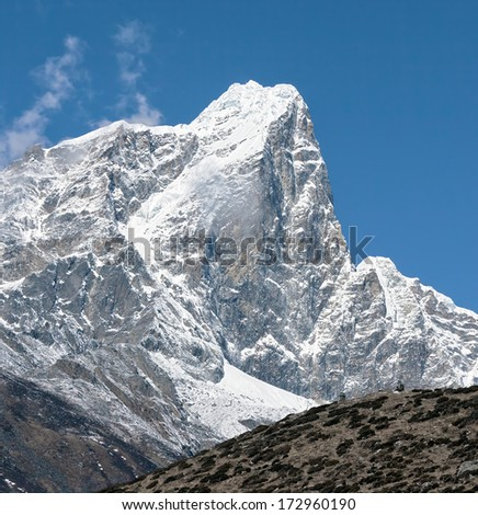 peak Tabuche. View from the village of Dingboche in the vallay Chhukhung - Everest region, Nepal, Himalayas - stock photo