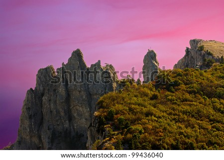 Peaks of Ai-Petri mountain at Black Sea shore (Crimea, Ukraine) at sunset time.