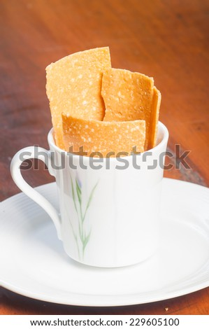 peanut brittle on a cup - stock photo
