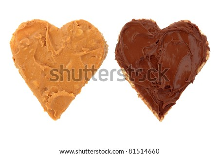Peanut butter and chocolate spread on heart shaped bread isolated over white background. - stock photo