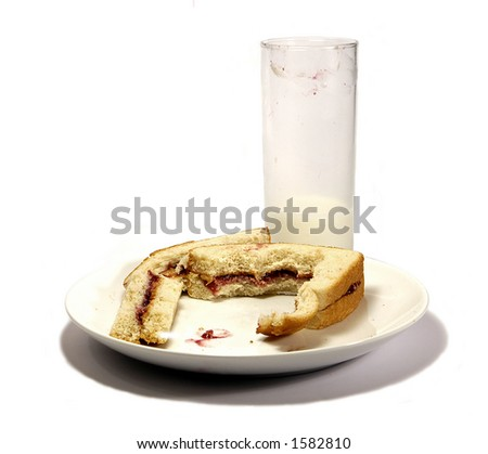 peanut butter and jelly sandwich half eaten-milk half finished - stock photo