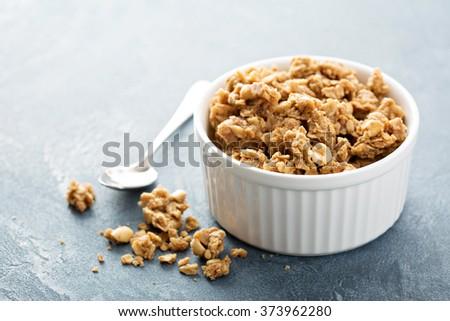 Peanut butter big cluster granola in white ramekin - stock photo