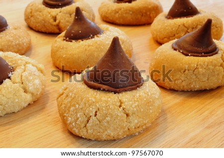 Peanut Butter Blossoms Cookies on a Wooden Cutting Board - stock photo