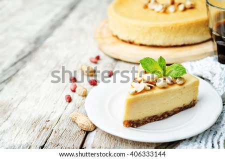 peanut butter cheesecake on a white wood background. toning. selective Focus - stock photo