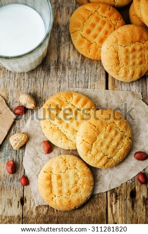 peanut butter cookies on a dark wood background. the toning. selective focus - stock photo