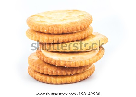 Peanut butter cream and biscuit in white background - stock photo